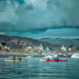 Kayaking past Oqaatsut in the Disko Bay in Greenland
