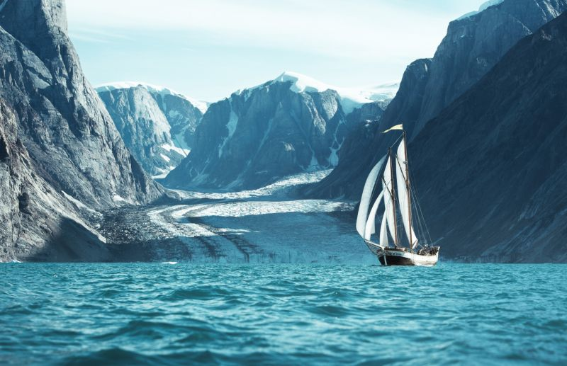 The sailing boat in front of an outlet glacier in Scoresbysund