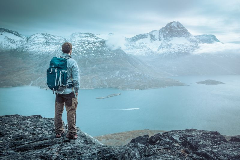 A hiker overlooking Kobberfjorden near Nuuk in Greenland