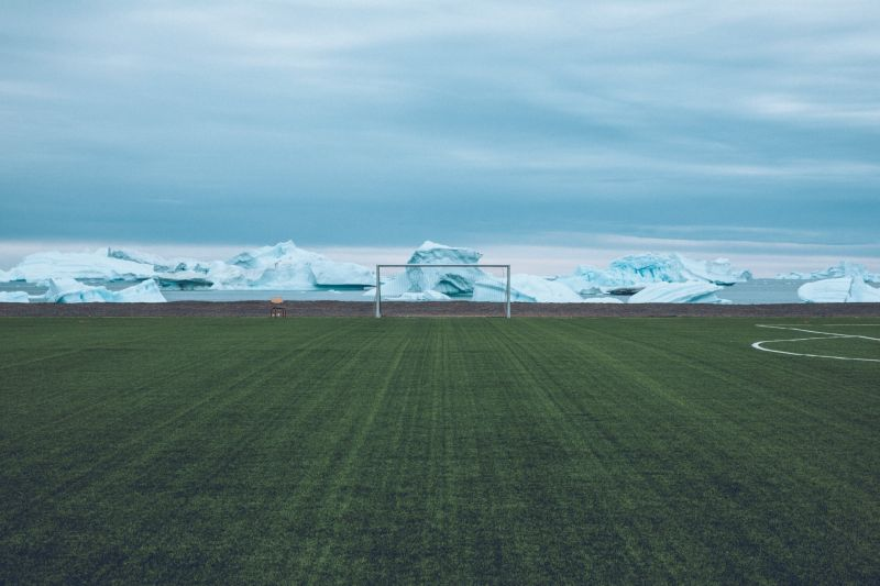 The football field in Qeqertarsuaq - surely on of the most surreal football fields in the world