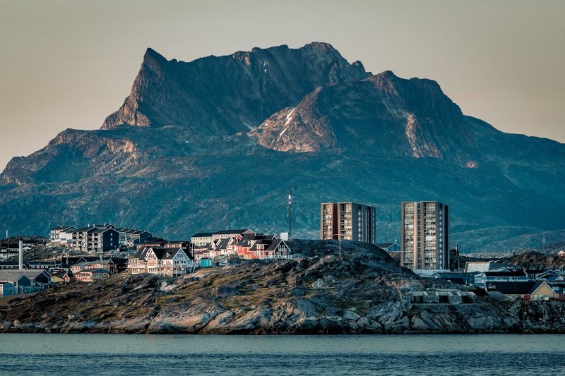 Buildings in Nuuk with the mountain Sermitsiaq in the background at sunset in Greenland