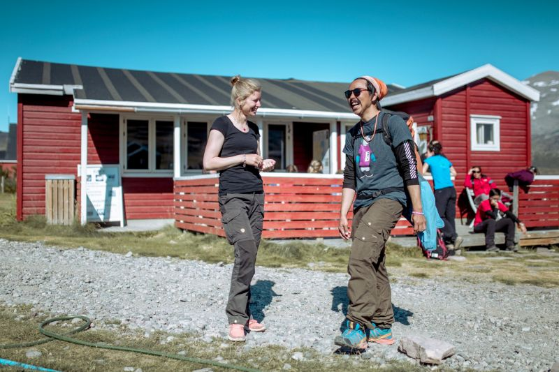 Guests enjoying a conversation outside Igaliku Country Hotel in South Greenland
