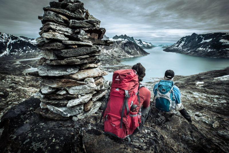 Two hikers overlooking Ikaasatsivaq sound in East Greenland near Tiniteqilaaq
