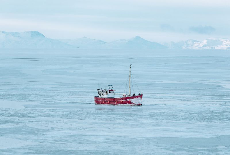 A tourist boat exploring disko bay in winter