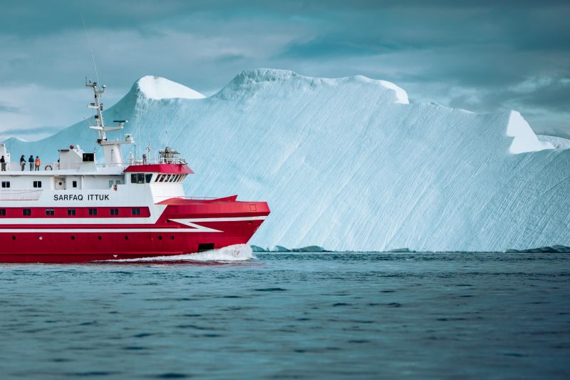 The Sarfaq Ittuk near an iceberg in Disko Bay