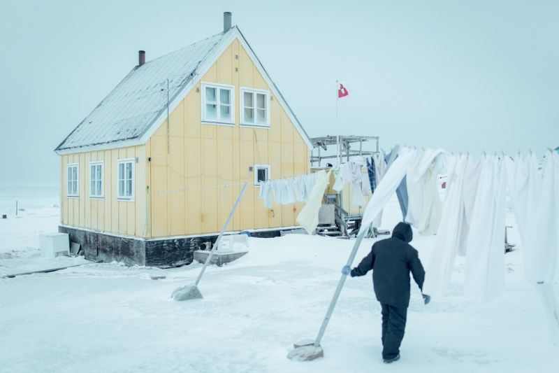 A woman walking to her house in Oqaatsut in Greenland