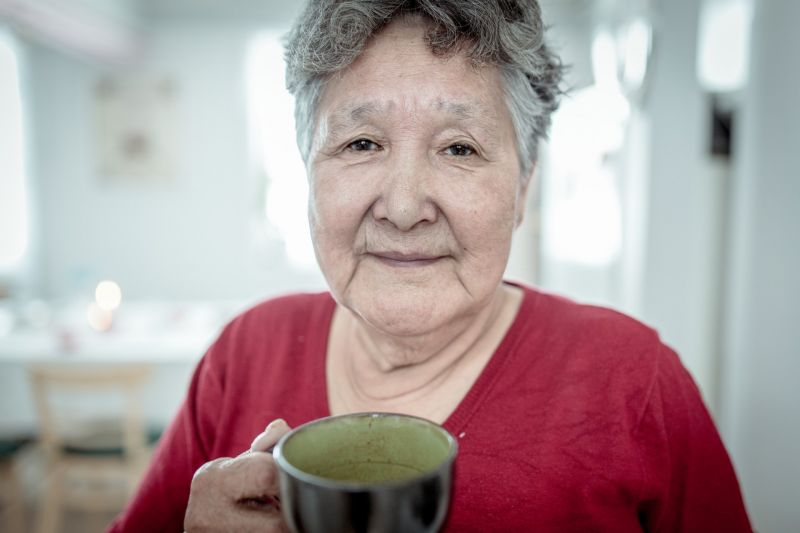 An elderly woman in her home in Oqaatsut in Greenland