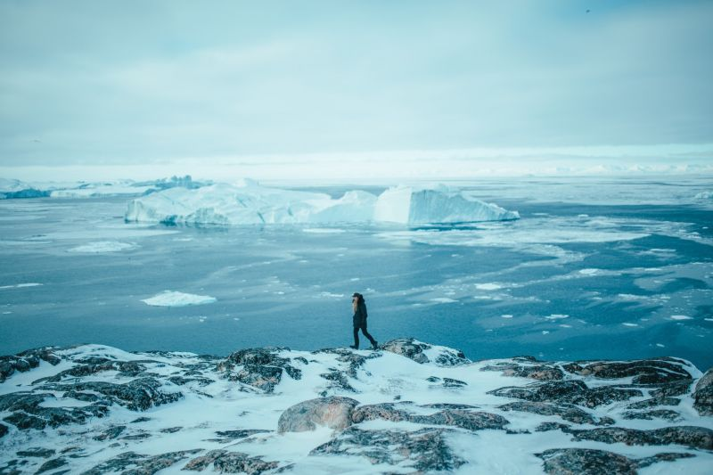 Walking near Ilulissat Icefjord with views over Disko Island and Disko Bay
