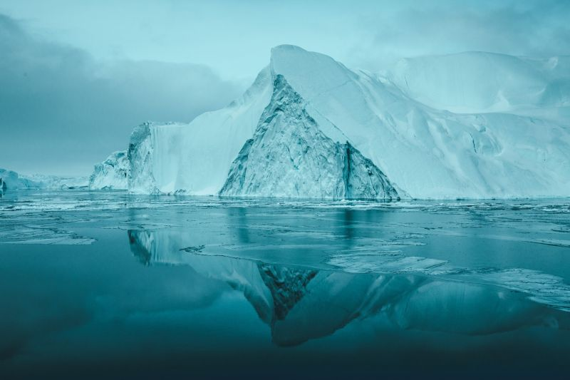Massive icebergs floating in Disko Bay Greenland