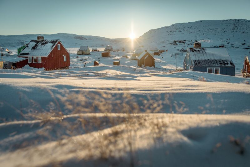 Sunrise over the village Oqaatsut in the Disko Bay in Greenland