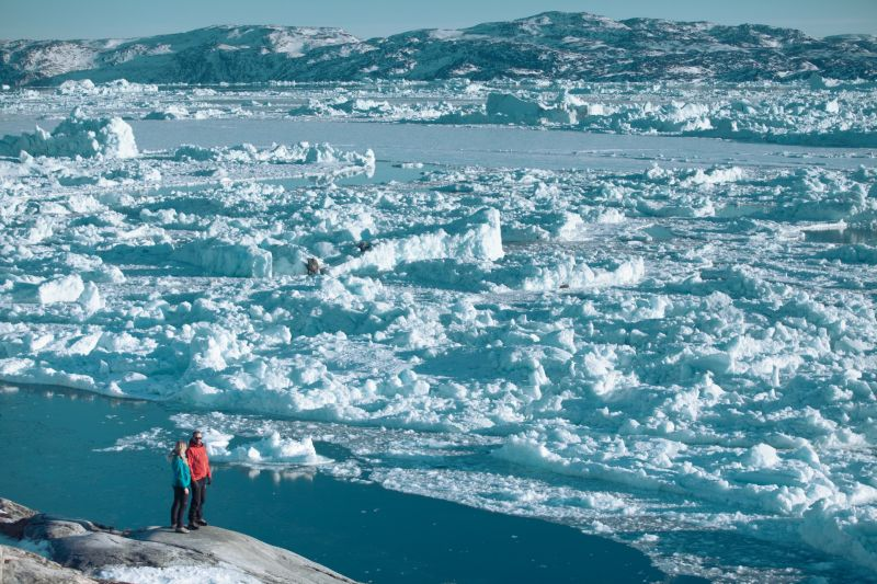View onto the sea ice and icebergs floating near Ilulissat