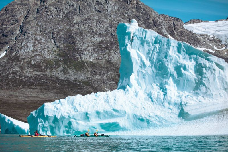 While kayaking in East Greenland we meet such frozen giants