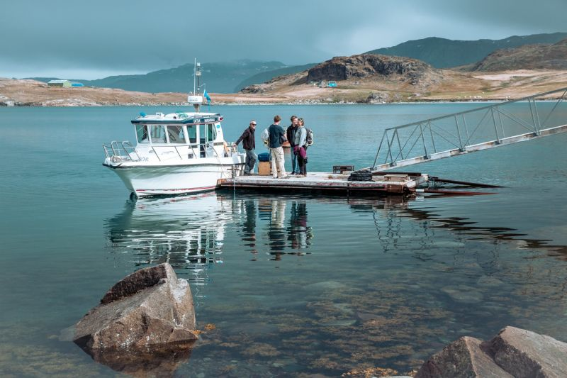 Guests boarding a transfer boat in South Greenland