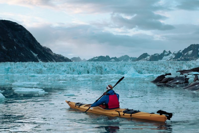 Paddling in front of Knud Rasmussen Glacier