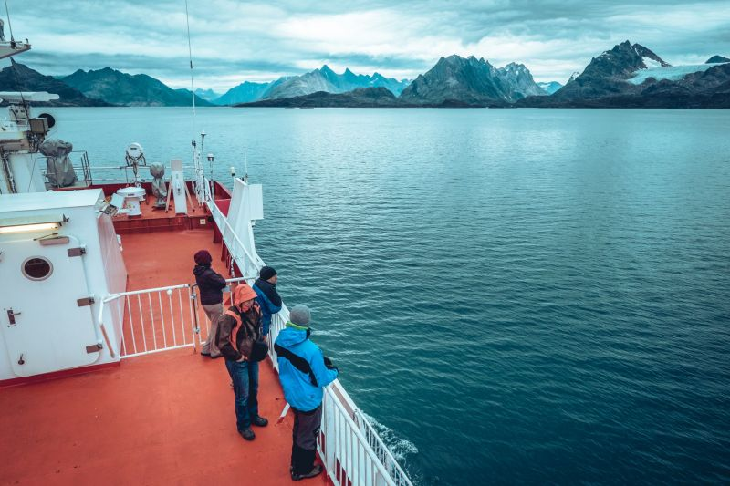 Passengers on the deck of Sarfaq Ittuk enjoying the view near Maniitsoq in Greenland