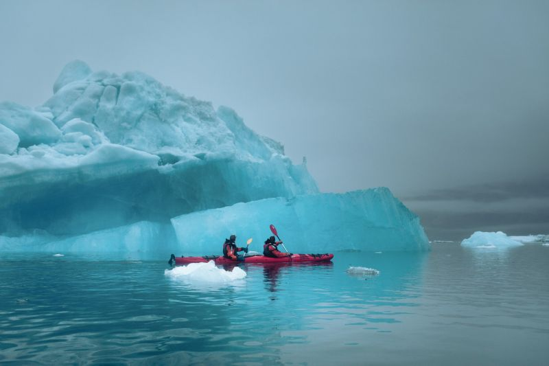Kayaking among spectacular ice formations in Tasiusaq Bay